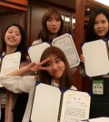 Four Duksung Women's University students pose with award certificates at the Sejong Hotel in Myeong-dong, central Seoul, Oct. 2, after being selected as an excellent team for the UNESCO Climate Change Youth Frontier Initiative. They include Hwang Nam-hee in the first row. Others are, from left in the second row, Park Si-hyun, Lee Han-nah, and Han Ji-hye. The team, named Limited Edition, launched an environmental campaign to promote using environment-friendly materials as cosmetic containers. (Courtesy of Duksung Women's University)