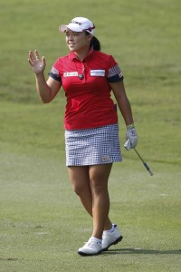 Ha Na Jang of South Korea gestures after hitting a shot on the second hole during the second round of the LPGA Malaysia golf tournament at Kuala Lumpur Golf and Country Club in Kuala Lumpur, Malaysia, Friday, Oct. 9, 2015.(AP Photo/Joshua Paul)