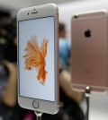 People look over the new Apple iPhone 6s models during a product display following an Apple event in San Francisco. Photography gets even better with Apple's new iPhones, making them worth getting for $100 more than last year's models.(AP Photo/Eric Risberg)