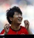Chinese pianist Lang Lang laughs as he performs during FC Bayern Munich show. (AP Photo/Matthias Schrader)