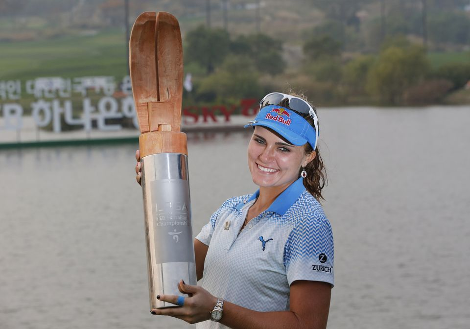 Lexi Thompson of the United States poses with the trophy after winning the LPGA KEB Hana Bank Championship golf tournament at Sky72 Golf Club in Incheon, South Korea, Sunday, Oct. 18, 2015. (AP Photo/Lee Jin-man)