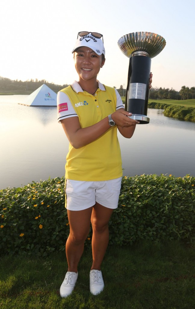 Lydia Ko of New Zealand displays her trophy after winning the LPGA Taiwan Championship at the Miramar Golf Country Club in Taipei county, Taiwan, Sunday, Oct. 25, 2015. (AP Photo)