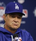 In this Monday, Oct. 12, 2015, file photo, Los Angeles Dodgers manager Don Mattingly speaks during a news conference before Game 3 of baseball's National League Division Series against the New York Mets in New York. A person familiar with the decision tells The Associated Press that Don Mattingly is out as manager of the Dodgers. The person spoke on the condition of anonymity Thursday, Oct. 22, 2015, because the team has not announced his departure. (AP Photo/Frank Franklin II, File)