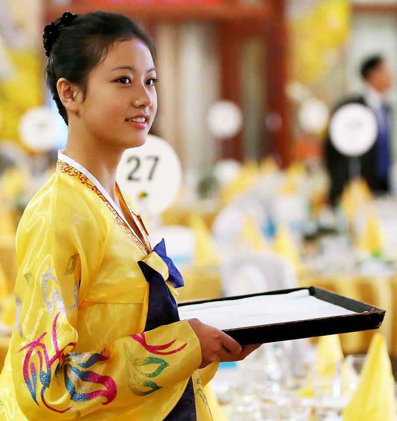 A North Korean hostess has gathered a bit of attention during the three-day reunion event. (Yonhap)