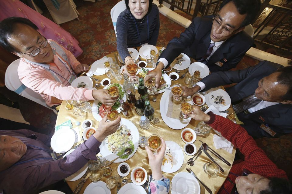 North Korean Kim Chang Ho, 87, second from right, toasts with his South Korean family members at a luncheon during the Separated Family Reunion Meeting at Diamond Mountain resort in North Korea, Wednesday, Oct. 21, 2015. Hundreds of elderly Koreans from divided North and South began three days of reunions Tuesday with loved ones many have had no contact with since the war between the countries more than 60 years ago. (Kim Do-hoon/Yonhap via AP)