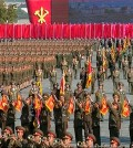In this image made from video, North Korean military personnel perform at the Kim Il Sung Square during the ceremony to mark the 70th anniversary of the country's ruling party in Pyongyang, Saturday, Oct. 10, 2015. North Korean leader Kim Jong Un declared Saturday that his country was ready to stand up to any threat posed by the United States as he spoke at a lavish military parade to mark the 70th anniversary of the North's ruling party and trumpet his third-generation leadership. (KRT via AP Video)