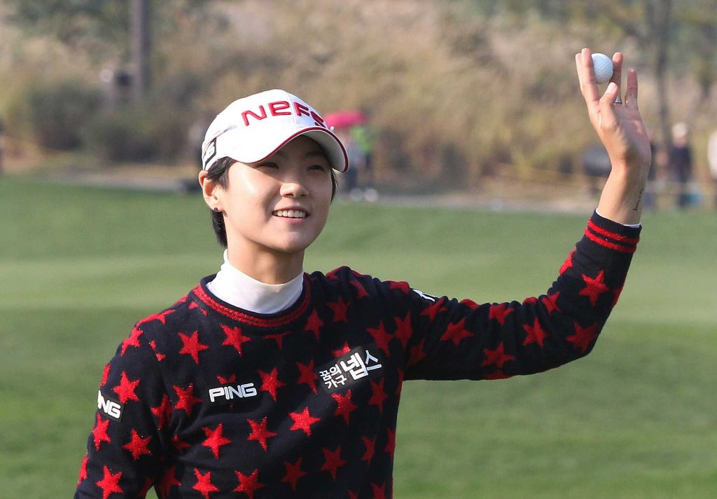 Park Sung-hyun of South Korea acknowledges spectators after sinking a birdie putt on the 18th green during the first round of the KEB Hana Bank Championship golf tournament at Sky72 Golf Club in Incheon, South Korea, Thursday, Oct. 15, 2015. (AP Photo/Ahn Young-joon)