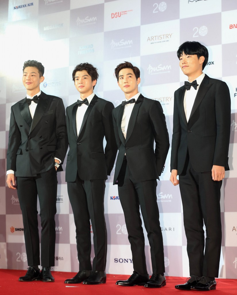 South Korean actors Kim Hee-chan, Ji-soo, EXO leader Suho and Choi Jung-yeol, left to right, attend the red carpet opening of the Busan International Film Festival Thursday. (Yonhap)