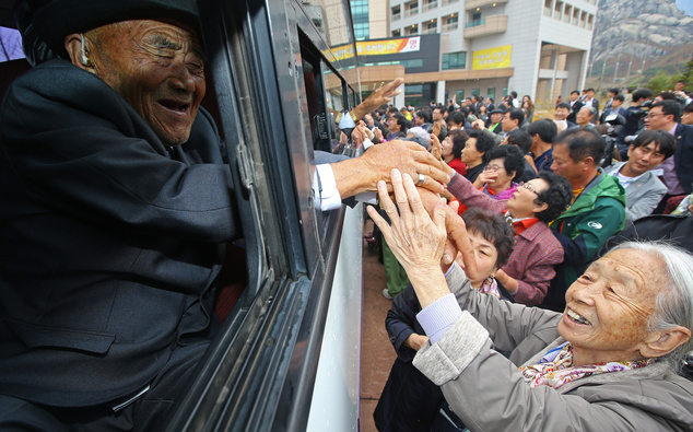 South Korean Lee Soon-kyu, 85, right, holds hands of her North Korean husband Oh In Se, 83, on a bus as they bid farewell after the Separated Family Reunion Meeting at the Diamond Mountain resort in North Korea, Thursday, Oct. 22, 2015. Hundreds of elderly Koreans are weeping and embracing as they part - perhaps for good - after briefly reuniting for the first time in more than 60 years. About 390 South Koreans traveled to the North's scenic Diamond mountain resort earlier this week to meet for three days with relatives they were separated from during the turmoil of the 1950-53 Korean War. (Kim Do-hoon/Yonhap)