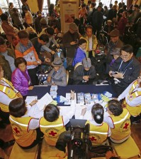South Koreans gather to resister for the upcoming family reunions with their North Korean family members at a hotel in Sokcho, South Korea, Friday, Oct. 23, 2015. South Koreans will travel to the Diamond Mountain resort in North Korea for the Separated Family Reunion Meeting, which begins Saturday and ends Monday. (Kim Do-hun/Yonhap)