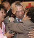South Korean Min Ho-shik, 84, center, hugs his North Korean family member Min Un Sik, right, during the Separated Family Reunion Meeting at Diamond Mountain resort in North Korea, Tuesday, Oct. 20, 2015. Hundreds of elderly Koreans from divided North and South began three days of reunions Tuesday with loved ones many have had no contact with since the war between the countries more than 60 years ago. At left is an unidentified family member of North Korean Min.(Kim Do-hoon/Yonhap via AP)