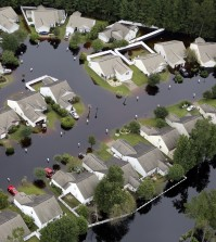 This aerial photo show flooding around homes in the Carolina Forest community in Horry County, between Conway and Myrtle Beach, S.C. The Carolinas saw sunshine Tuesday after days of inundation, but it could take weeks to recover from being pummeled by a historic rainstorm that caused widespread flooding and multiple deaths. (Janet Blackmon Morgan/The Sun News via AP)