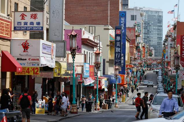 Pedestrians walk along Grant Avenue in San Francisco's Chinatown. The neighborhood is the birthplace of Chinese America, and to some extent, the broader Asian America that descended from immigration over the Pacific Ocean throughout the 19th and 20th centuries. (AP Photo/Eric Risberg)