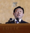 In this Tuesday, Aug. 11, 2015 file photo, Lotte group Chairman Shin Dong-bin issues a public apology at Lotte Hotel in Seoul, South Korea. When South Korean Chung Yu-suk read an article about retailer Lotte's chocolate ads featuring a Japanese figure skating star, he was so angered he started an online group urging Koreans to boycott their country's top retailer. Chung is one of a growing number of South Koreans vowing to punish Lotte after a family battle for control of the company spilled out in public and highlighted their deep links to Japan, Korea's former colonizer. (AP Photo/Lee Jin-man, File)