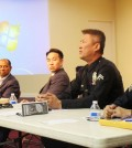 LAPD Officer Henry Choi, second from right, speaks during a seminar on elder abuse Saturday inside a Korean church.