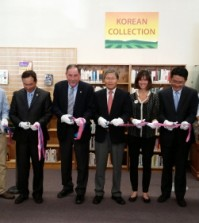 Local Korean and American community leaders, including Salinas Mayor Joe Gunter, fourth from left, and San Francisco Korean Consul General Han Dong-man, to his right, held a ribbon-cutting ceremony Sunday inside John Steinbeck Library to celebrate the opening of the Korean collection.