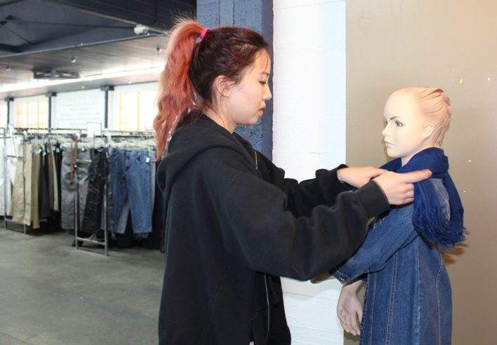 Volunteer Heejin Park, from a Korean Catholic young adults group, dresses a manikin at St. Vincent de Paul Thrift Store in downtown L.A. ((Courtesy of St. Vincent de Paul of Los Angeles / Kay Hwangbo)