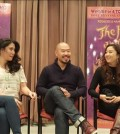 Hoon Lee, center, sits with co-stars Ashley Park, right, and Ruthie Ann Miles.