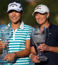 Lydia Ko, left, and Cristie Kerr hold their trophies at the conclusion of the CME Group Tour Championship golf tournament on Sunday, Nov. 22, 2015, in Naples, Fla. (David Albers/Naples Daily News via AP)