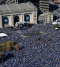 Thousands gather for a rally to celebrate the Kansas City Royals winning baseball's World Series at Union Station Tuesday, Nov. 3, 2015, in Kansas City, Mo. The Royals beat the New York Mets in five games to win the championship. (AP Photo/Reed Hoffmann)