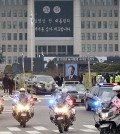 A vehicle putting up a portrait of the late former South Korean President Kim Young-sam leads a hearse after the state funeral for Kim at the National Assembly in Seoul, South Korea, Thursday, Nov. 26, 2015. Thousands of mourners gathered at the lawn outside parliament Thursday to say their farewells to Kim, whose landmark 1992 election victory ended decades of military rule and ushered in a series of reform measures. (AP Photo/Ahn Young-joon. Pool)