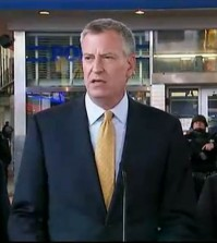 In this photo provided by WNYW Fox 5 NY, New York Mayor Bill de Blasio speaks during a news conference in New York's Times Square, Wednesday, Nov. 18, 2015. The New York Police Department says it's aware of a newly released Islamic State group video showing images of Times Square but says there's no current or specific threat to the city. (WNYW Fox 5 NY via AP)