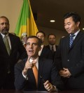Los Angeles Mayor Eric Garcetti (sitting) speaks to reporters as Councilman David Ryu (right) listens. (Courtesy of David Ryu staff)