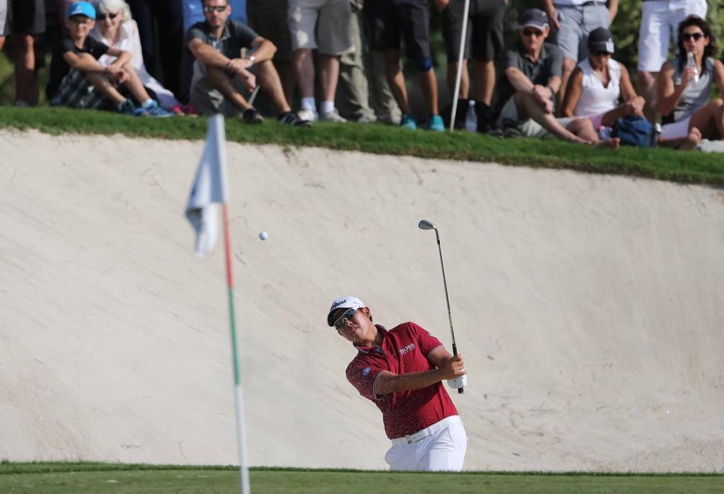 An Byeong-hun of South Korea plays a bunker shot on the 15th hole during the third round of DP World Tour Championship golf tournament in Dubai, United Arab Emirates, Saturday, Nov. 21, 2015. (AP Photo/Kamran Jebreili)