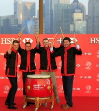 From left to right, Tennis players Henrik Stenson, Rickie Fowler, Jordan Spieth, Bubba Watson, hold drum sticks for photo during the HSBC Champions golf tournament photocall in Shanghai, China Thursday Nov.3, 2015. (AP Photo)