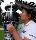 Inbee Park kisses the championship trophy after winning the Lorena Ochoa Invitational in Mexico. (AP)