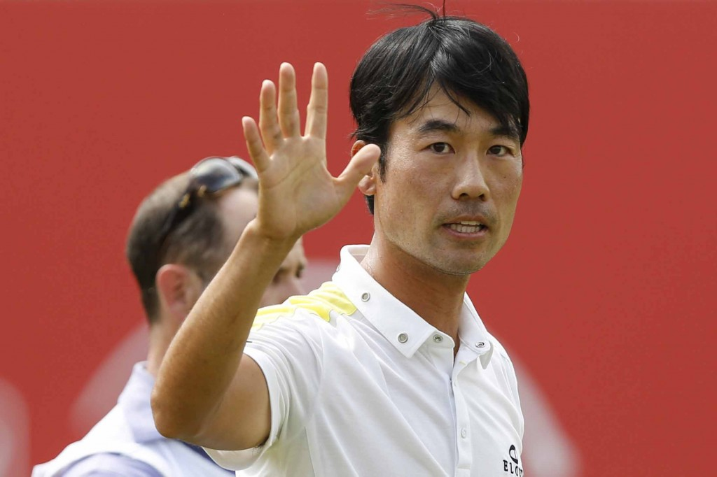 Kevin Na of the United States waves after finishing the 18th hole during the third round of CIMB Classic golf tournament at Kuala Lumpur Golf and Country Club in Kuala Lumpur, Malaysia, Saturday, Oct. 31, 2015. (AP Photo/Joshua Paul)