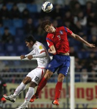 South Korea's Koo Ja-cheol, right, fights for the ball with Myanmar's Kyaw Ko Ko during their Asian zone Group G qualifying soccer match for the 2018 FIFA World Cup at Suwon World Cup Stadium in Suwon, South Korea, Thursday, Nov. 12, 2015. South Korea defeated Myanmar 4-0. (AP Photo/Lee Jin-man)