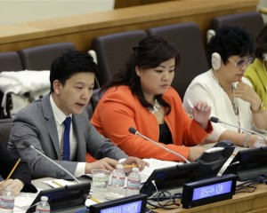 North Korean defectors Joseph Kim, left, Jay Jo, center, and Kim Hye-Sook participate in a panel on North Korean human rights abuses at United Nations headquarters, Thursday, April 30, 2015. (AP Photo/Seth Wenig)