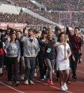 Foreign runners join a ceremony to mark the annual Pyongyang Marathon in this photo taken in August 2014. North Korea plans to invite up to 1,500 marathoners from abroad in April next year.  (Courtesy of Koryo Tours)