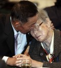 North Korean Han Son-il, left, hugs with his South Korean mother Lee Kum-seok to bid farewell after the Separated Family Reunion Meeting at Diamond Mountain resort in North Korea, Monday, Oct. 26, 2015. Parents and children, brothers and sisters and other relatives separated by the Korean war wept and hugged each other as they parted after their brief reunions, most for the first time in more than six decades. (Kim Do-hoon/Yonhap)