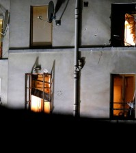 In this Wednesday, Nov. 18, 2015 file photo, bullet holes are pictured around a window on the back side of the house after an intervention of security forces against a group of extremists in Saint-Denis, near Paris. A woman wearing an explosive suicide vest blew herself up Wednesday as heavily armed police tried to storm a suburban Paris apartment where the suspected mastermind of last week's attacks was believed to be holed up, police said. While most suicide bombers are men, Islamic militant groups have occasionally deployed women to carry out such attacks. Long before the rise of Islamic radicalism, women suicide bombers were used by leftist and separatist groups in the Arab and beyond. (AP Photo/Michel Euler)
