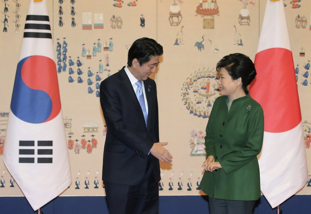 Japanese Prime Minister Shinzo Abe, left, offers his hand to shake hands with South Korean President Park Geun-hye before their meeting at the presidential Blue House in Seoul, South Korea, Monday, Nov. 2, 2015. (Lee Jung-hun/Yonhap