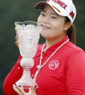 Sun-ju Ahn of South Korea smiles with a trophy after winning the Toto Japan Classic, her first LPGA Tour victory, in Shima, central Japan. Ahn won the 20th Japan LPGA title, beating fellow South Korean player Ji-Hee Lee and American Angela Stanford with a birdie on the first hole of a playoff. (Naoya Osato/Kyodo News via AP)