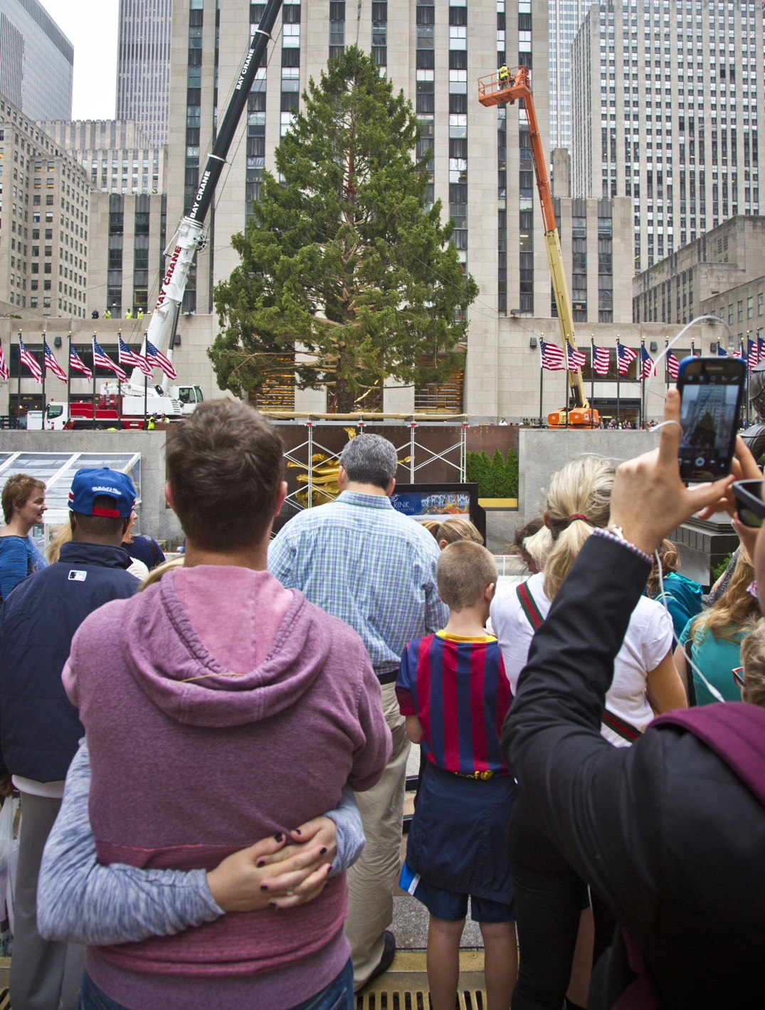 78 foot christmas tree hoisted into place at rockefeller center