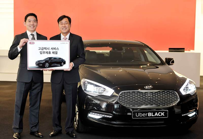 Calvin Kang (L), general manager of Uber Korea, and Cho Yong-won, head of the sales division at Kia Motors, stand by a K9 model ahead of the joint relaunch of UberBlack in Seoul on Nov. 11, 2015. (Photo courtesy of Uber Korea)