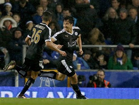 Leicester City's Shanji Okazaki of Japan, right, celebrates after scoring a goal during the English Premier League soccer match at Goodison Park, Liverpool, England, Saturday Dec.19, 2015. (Peter Byrnev / PA via AP)