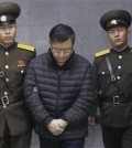 Hyeon Soo Lim, center, who pastors the Light Korean Presbyterian Church in Toronto, is escorted to his sentencing in Pyongyang, North Korea, Wednesday, Dec. 16, 2015. North Korea's Supreme Court sentenced a Canadian pastor to life in prison with hard labor on Wednesday for what it called crimes against the state. (AP Photo/Jon Chol Jin)