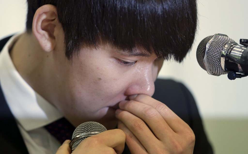 Former Olympic swimming champion Park Tae-hwan of South Korea holds back his tears during a news conference in Seoul, South Korea, Friday, March 27, 2015. Former Olympic swimming champion Park Tae-hwan of South Korea offered a public apology Friday, four days after receiving an 18-month ban for failing a doping test. (AP Photo/Lee Jin-man)