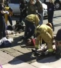 Rescue crews tend to the injured in the intersection outside the Inland Regional Center in San Bernardino, California in this still image taken from video December 2, 2015. At least 20 people were reported injured in an active shooter situation, according to news reports. (Reuters/NBCLA.com/Yonhap)