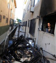 A representative from the  management company of the apartment inspects the premises after the fire was extinguished. (Korea Times photo by Park Sang-hyuk)