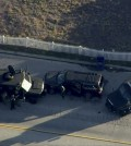 Police armored cars close in on a suspect vehicle following a shooting incident in San Bernardino, California in this still image taken from video December 2, 2015. Gunmen opened fire on a holiday party on Wednesday at a social services agency in San Bernardino, killing 14 people and wounding 17 others before fleeing, authorities said. (Reuters/NBCLA.com via Yonhap)