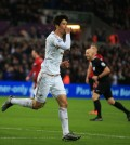 Swansea City's Ki Sung-yueng celebrates scoring the opening goal against West Bromwich Albion during the English Premier League soccer match at the Liberty Stadium, Swansea, Wales, Saturday Dec. 26, 2015. (Nick Potts/PA via AP)