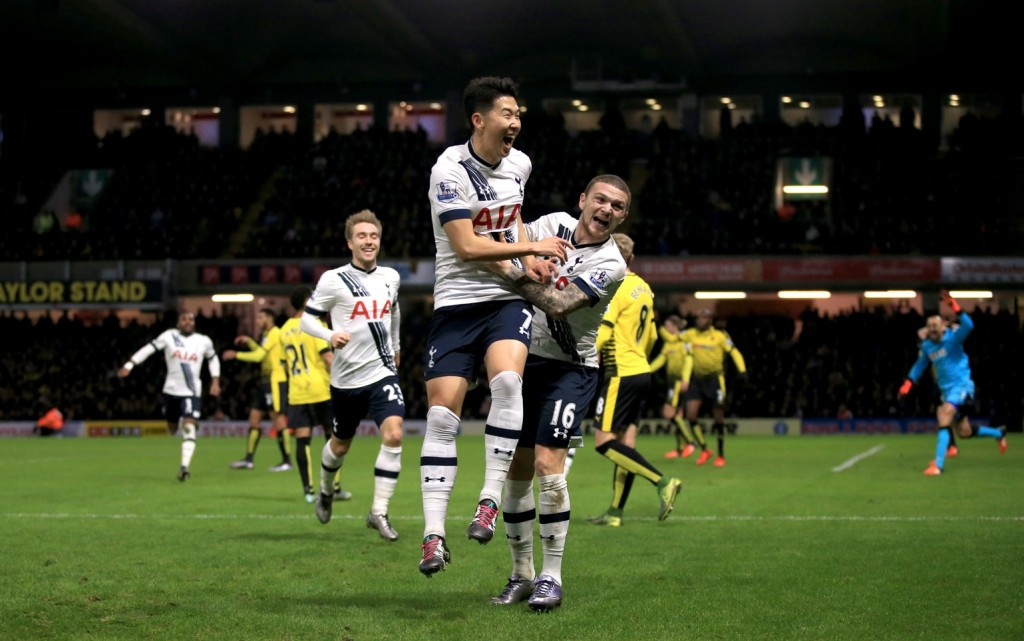 Tottenham Hotspur's Son Heung-Min, centre left, celebrates scoring his side's second goal of the game with teammate Kieran Trippier, during the English Premier League match between Watford and Tottenham Hotspur, at Vicarage Road, in Watford, England, Monday Dec. 28, 2015. (Nick Potts/PA via AP)