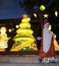 A monk wearing a Santa hat walks past Christmas lights and decorations set up at the Jogye Temple in Seoul on Dec. 16, 2015. The temple is of the Jogye Order, the largest Buddhist sect in the country. (Yonhap)
