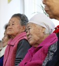 Former South Korean sex slaves, who were forced to serve for the Japanese Army during World War II, wait for results of a meeting of South Korean and Japanese foreign ministers at the Nanumui Jip, The House of Sharing, in Gwangju, South Korea, Monday, Dec. 28, 2015. The foreign ministers said Monday they had reached a deal meant to resolve a decades-long impasse over Korean women forced into Japanese military-run brothels during World War II, a potentially dramatic breakthrough between the Northeast Asian neighbors and rivals. (Hong Ji-won/Yonhap via AP)